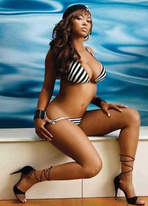 Hot and sexy black woman in bikini with big tits