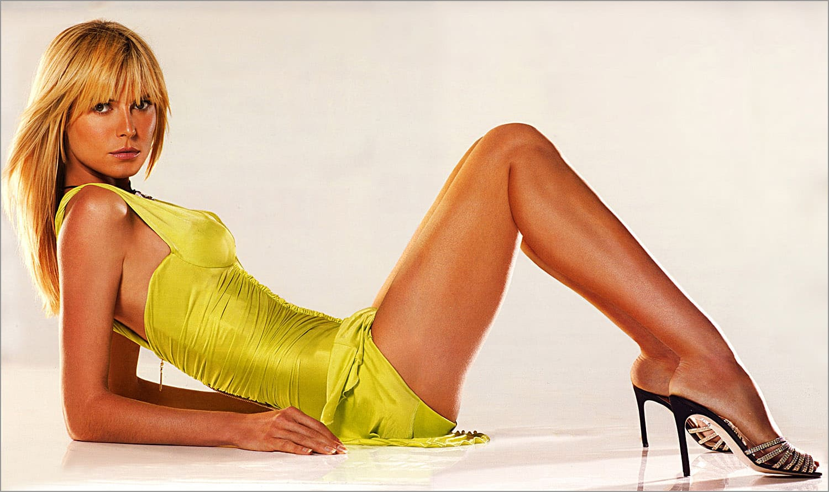 Sexy blonde model girl in bikini with a beautiful figure