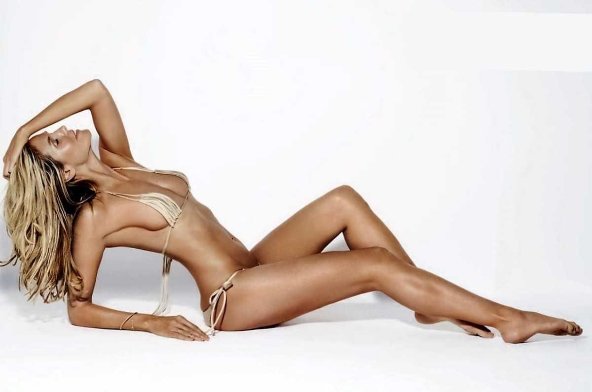Sexy blonde model girl in bikini with a beautiful figure in a sexy body