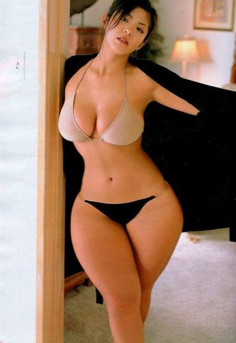 Sexy Chinese girl in a bikini with big tits and a gorgeous figure.
