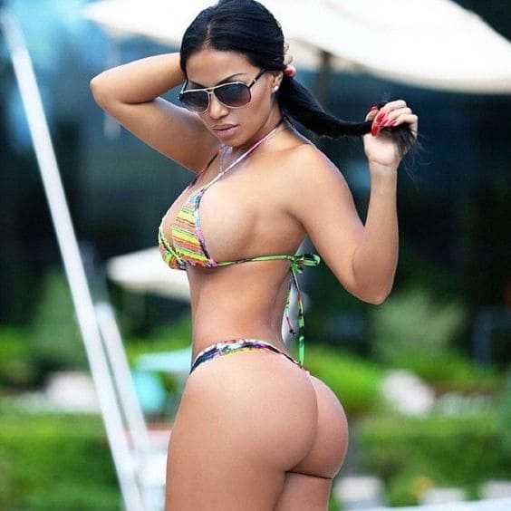 Hot babe with sexy body big boobs in a bikini