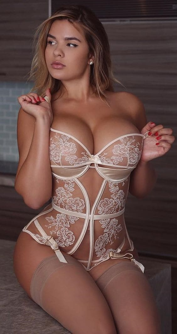 Sexy girl with big tits in stockings pics.
