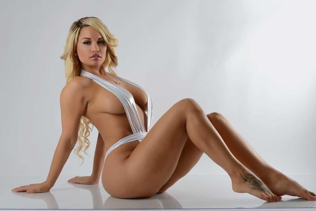 Hot sexy blonde girl with big boobs, a cool ass bikini