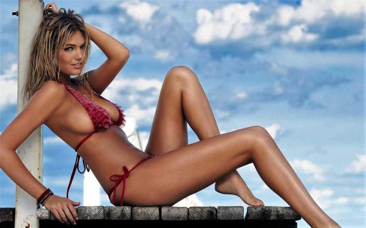Sexy girl model in a bikini with beautiful tits