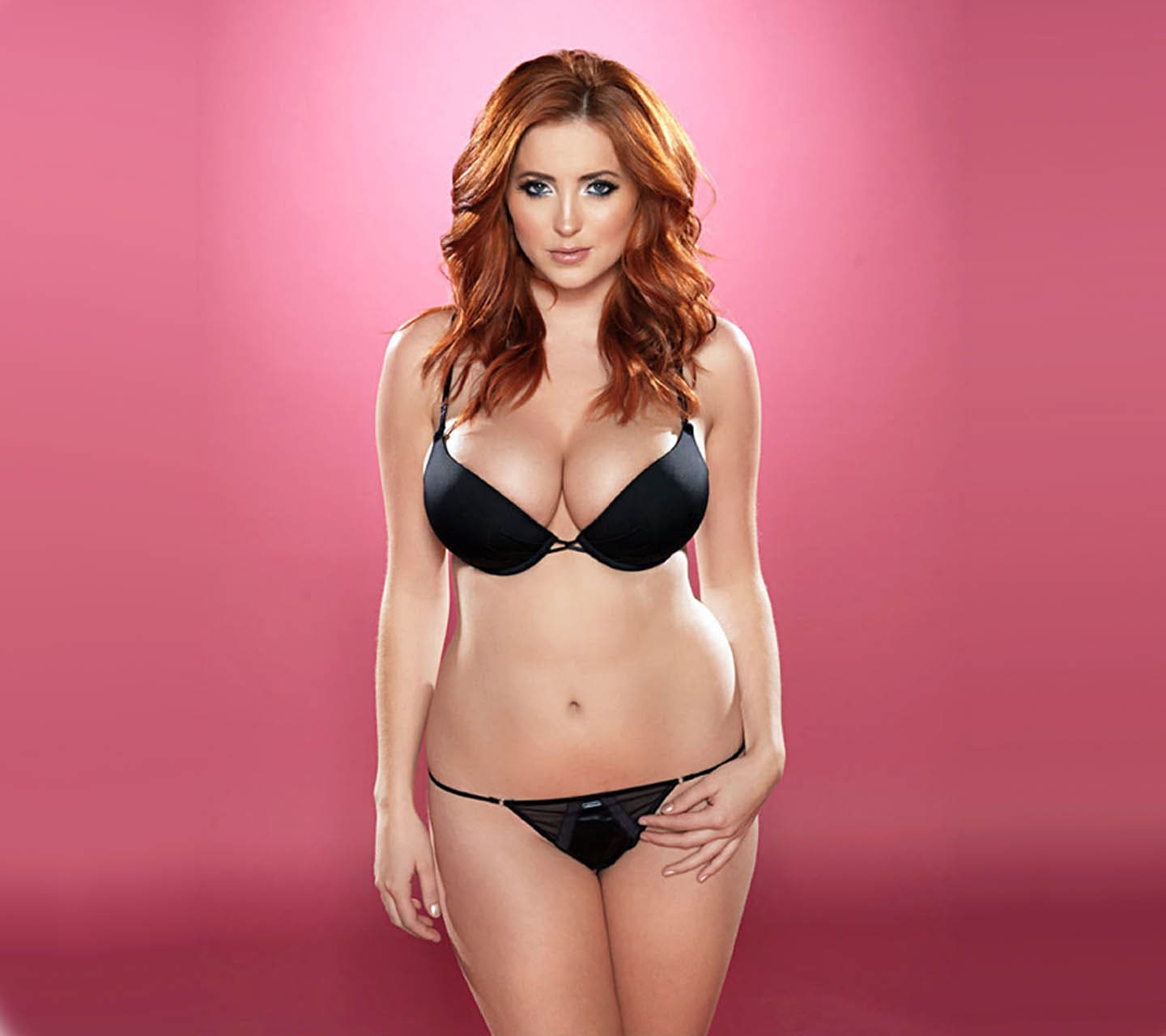 Redhead girl. Beauty with big tits in a bikini
