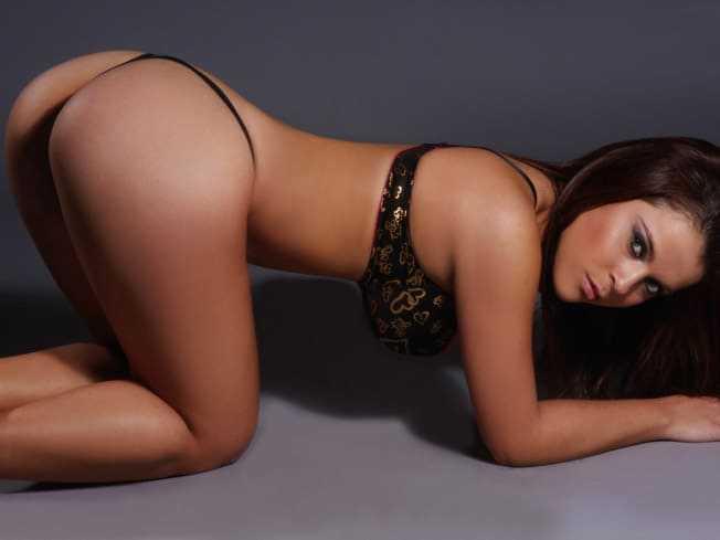 Beautiful girl with a sexy figure in a hot ass in a bikini