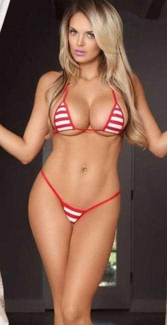 Sexy slim blonde with big tits and in a bikini