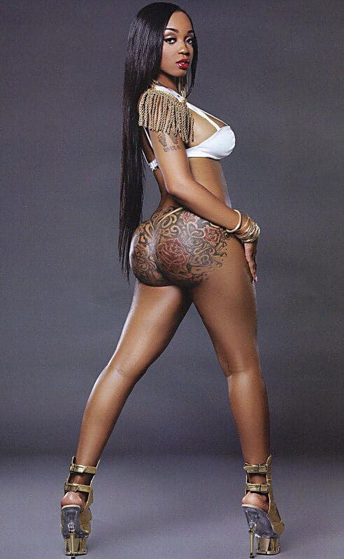 Sexy and slim black girl with a big ass in tattoos