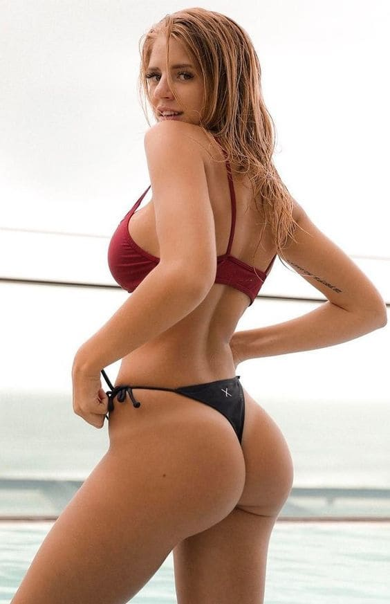 A girl with a beautiful figure and an ass in a bikini
