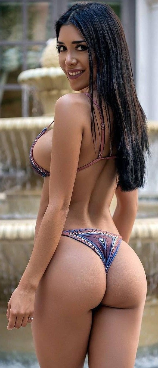Sexy girl in a bikini with beautiful tits and ass.