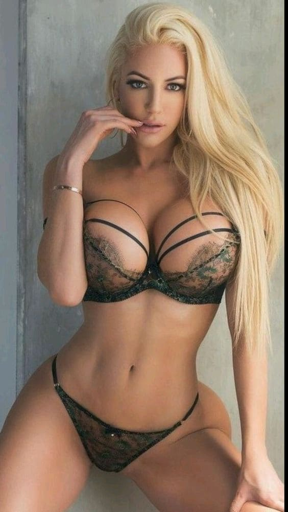 Hot and slender blonde girl in lingerie with a sexy figure, big boobs