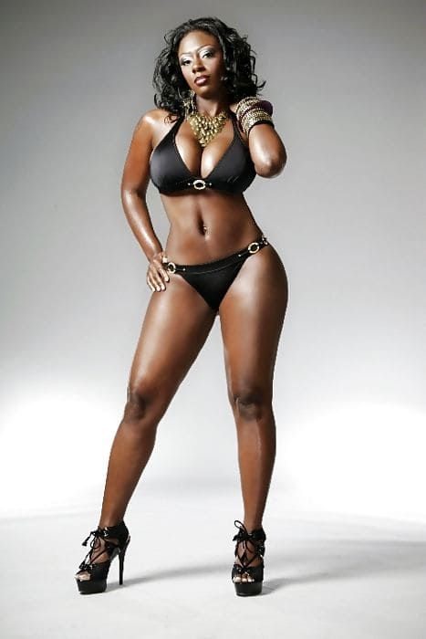 Sexy hot black woman in bikini with big tits and slim figure